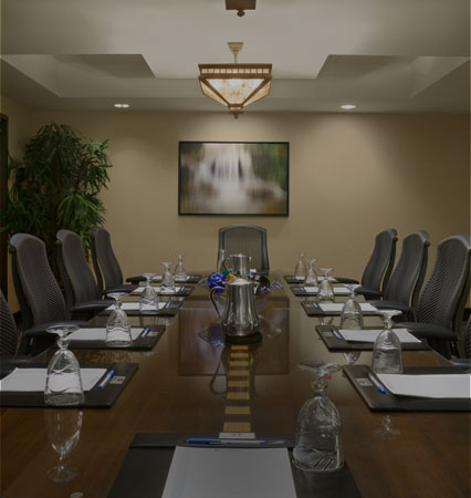Meeting Table with Black Chairs