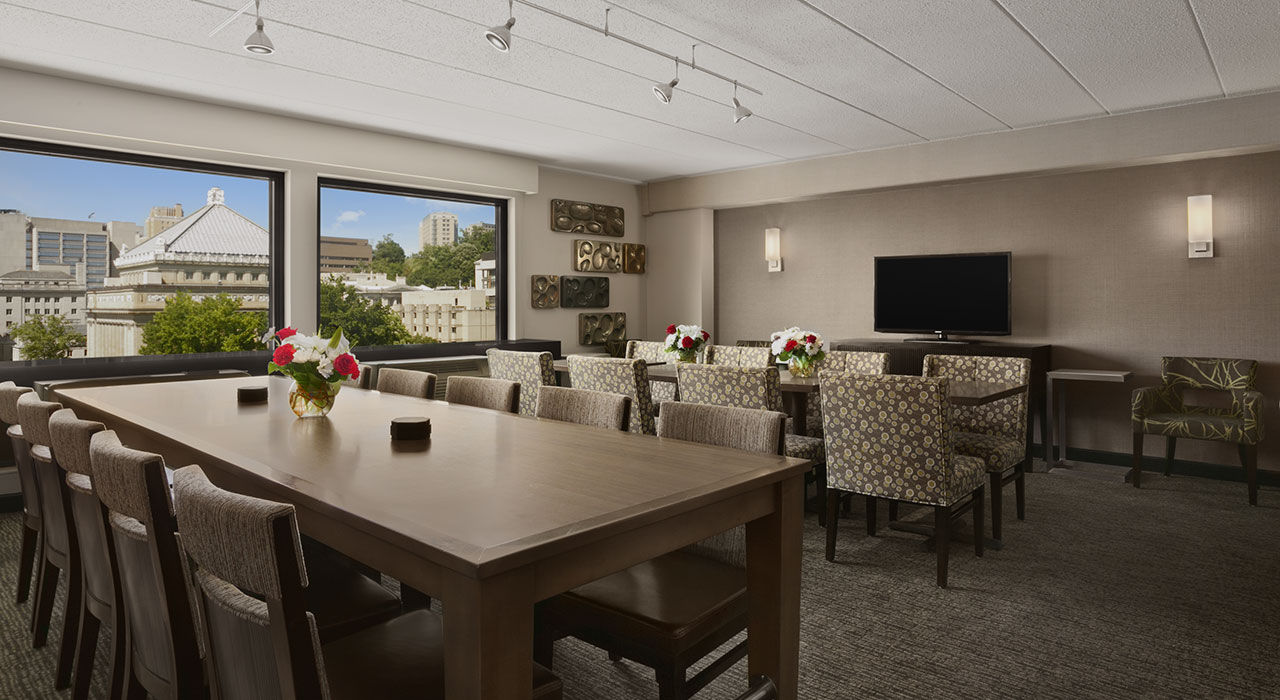 Pittsburgh University Center Indoor Pool Meeting Room With Tables Tv Hotel Hallway
