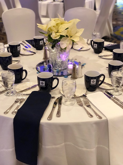 Event Table Setting With Floral Centerpiece